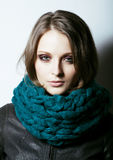Young pretty real woman in sweater and scarf all over her face s Royalty Free Stock Image