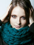 Young pretty real woman in sweater and scarf all over her face smiling Royalty Free Stock Images