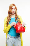 Young pretty red hair girl looking confused in her bag isolated on white background, lifestyle people concept Stock Images