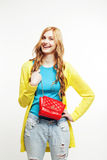 Young pretty red hair girl looking confused in her bag isolated on white background, lifestyle people concept Stock Image