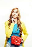 Young pretty red hair girl looking confused in her bag isolated on white background, lifestyle people concept Royalty Free Stock Image