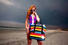 Young Pretty Red Haired Woman playing on a Beach. Young Pretty Red Haired Woman playing on a sea-side Beach Royalty Free Stock Photos