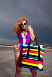 Young Pretty Red Haired Woman playing on a Beach Royalty Free Stock Photo