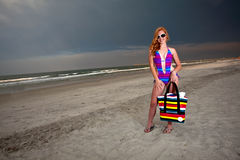 Young Pretty Red Haired Woman playing on a Beach Stock Photo