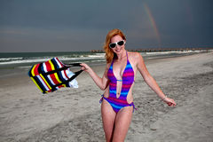 Young Pretty Red Haired Woman playing on a Beach Royalty Free Stock Images