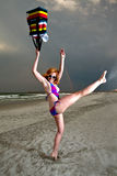 Young Pretty Red Haired Woman playing on a Beach Stock Image