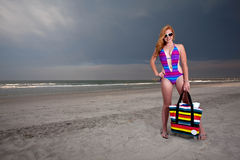 Young Pretty Red Haired Woman playing on a Beach Stock Images