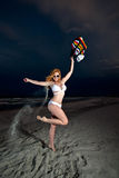 Young Pretty Red Haired Woman playing on a Beach Royalty Free Stock Photography