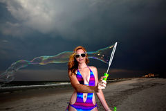 Young Pretty Red Haired Woman playing on a Beach Stock Photography