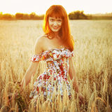 Young pretty red woman at the field Royalty Free Stock Photos