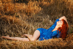 Young pretty red woman at the field Stock Photography