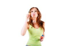 Young pretty seductive girl blow bubbles Stock Image