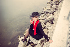 Young pretty lady in black dress outdoor Royalty Free Stock Photos