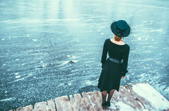 Young pretty lady in black dress outdoor Stock Photography
