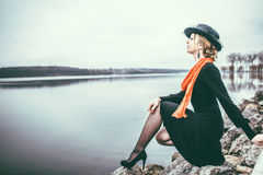 Young pretty lady in black dress outdoor Royalty Free Stock Image