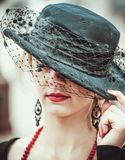 Young pretty sexy lady in black vintage hat outdoor Stock Photos