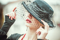 Young pretty sexy lady in black vintage hat outdoor Royalty Free Stock Images