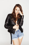 Young pretty sexy woman in leather jacket Stock Images
