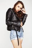 Young pretty sexy woman in leather jacket Stock Photography