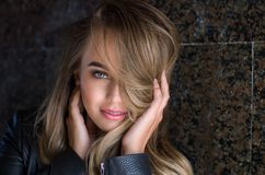 Young pretty sexy woman in leather jacket, lifestyle hipster gir. Portrait of a beautiful girl stock image