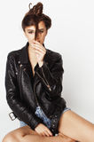 Young pretty sexy woman in leather jacket, lifestyle hipster girl posing isolated on white background. Skinny modern beauty Stock Images