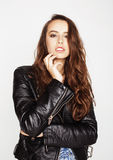 Young pretty sexy woman in leather jacket, lifestyle hipster girl posing  on white background. People concept Stock Photography