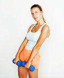 Young pretty slim blond woman with dumbbell  cheerful smiling, measuring herself, diet people concept Stock Images