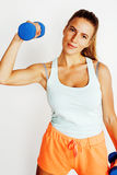 Young pretty slim blond woman with dumbbell isolated cheerful smiling, measuring herself, diet people concept Stock Photo