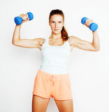 Young pretty slim blond woman with dumbbell isolated cheerful smiling, measuring herself, diet people concept Royalty Free Stock Image