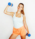 Young pretty slim blond woman with dumbbell isolated cheerful smiling, measuring herself, diet people concept Stock Photography