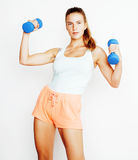 Young pretty slim blond woman with dumbbell isolated cheerful smiling, measuring herself, diet people concept Royalty Free Stock Photography
