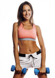 Young pretty slim woman with dumbbell isolated Stock Photo