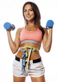 Young pretty slim woman with dumbbell isolated. Cheerful smiling Stock Photos