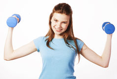 Young pretty slim woman with dumbbell isolated Stock Photos