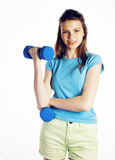Young pretty slim woman with dumbbell isolated cheerful smiling, real sport girl next door, lifestyle people concept Royalty Free Stock Photo