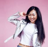 Young pretty smiling asian korean girl wearing modern fashion cl stock images