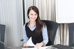 Young pretty smiling business woman. With notebook in the office Stock Photos