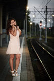 Young pretty smiling girl dressed in a bright dress Stock Photo