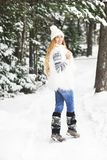 Young pretty smiling girl outdoors at winter forest Stock Photos