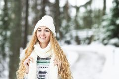 Young pretty smiling girl outdoors at winter forest Royalty Free Stock Photography