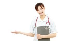 Young pretty smiling nurse welcoming you Royalty Free Stock Image