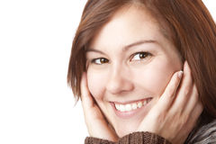 Young, pretty smiling woman with hands on face stock images