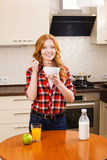 Young pretty smiling woman having a bowl of cereal Stock Image