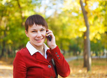 Young pretty smiling woman talking on cell phone Stock Image