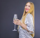 Young pretty smilling woman with glass of champagne Stock Photo