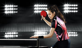Young pretty sporty girl playing table tennis. Portrait Of Young Woman Playing Tennis Stock Images