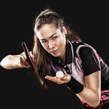 Young pretty sporty girl playing table tennis on. Portrait Of Young woman Playing Tennis On Black Background Stock Image