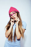 Young pretty stylish blond hipster girl posing emotional isolated on white background happy smiling cool smile. Lifestyle people concept close up Royalty Free Stock Photos
