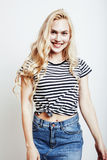 Young pretty stylish blond hipster girl posing emotional isolated on white background happy smiling cool smile Stock Photos