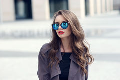 Young pretty stylish girl in sunglasses Stock Images
